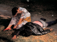 Enrique Metinides, A woman mourns the death of a friend, killed in Chapultepec-Park, while resisting robbers, Mexico City, 1995, courtesy of the Kurimanzutto gallery in Mexico City, photo by: Enrique Metinides.